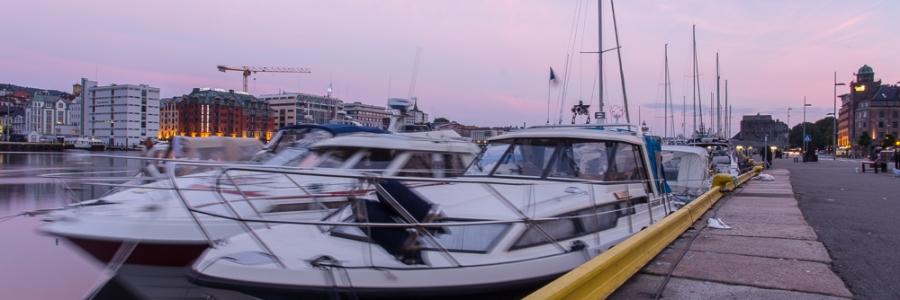 Båter i soloppgang Bryggen Bergen